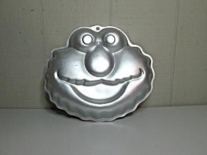 wilton elmo cake pan instructions